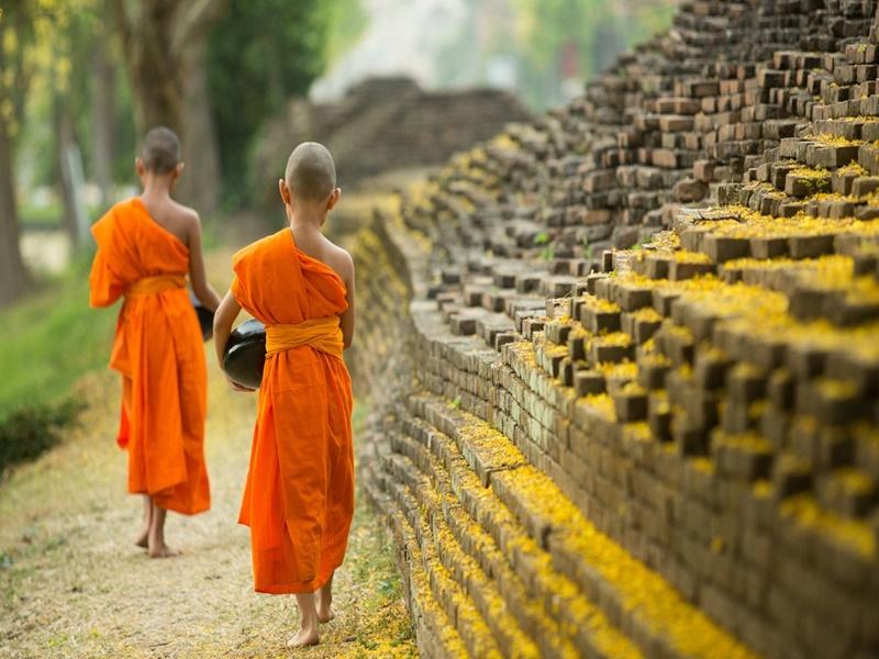 Buddhist Monk walking to receive alms